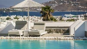 Seasonal outdoor pool, open 10 AM to 6:30 PM, pool umbrellas