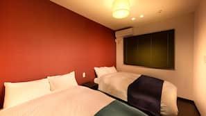 Down comforters, memory foam beds, blackout drapes, free WiFi