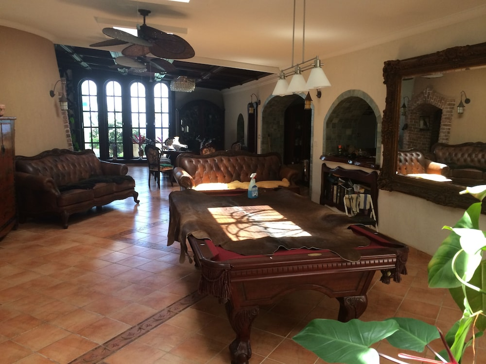 Living Room, 2 Bedroom Apartment in Mountain top Villa With Pool.