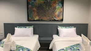 Premium bedding, pillow top beds, minibar, individually decorated
