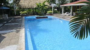 2 outdoor pools, open 7 AM to 10 PM, pool umbrellas