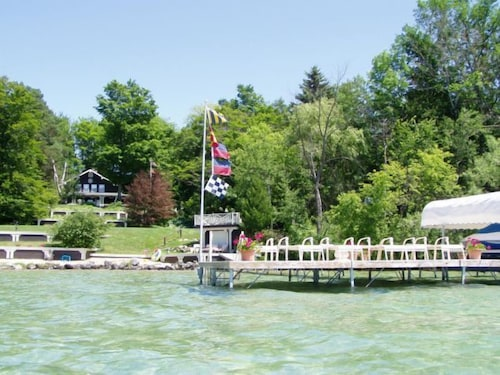 Beautiful Torch Lake Sunset Views ~ Tennis Court ~ Includes Kayaks ~ Playset!