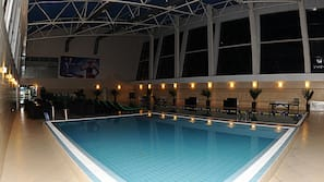 Indoor pool, open 7 AM to 11 PM, pool umbrellas