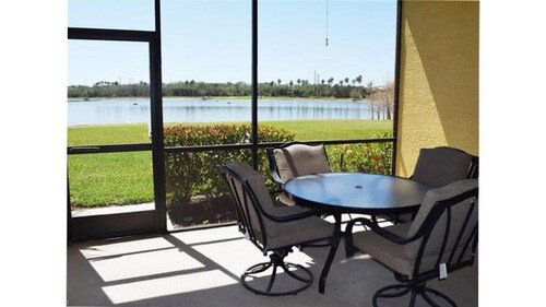 Spacious 1st Floor Condo With Spectacular Views of the Large Lake and Clubhouse!