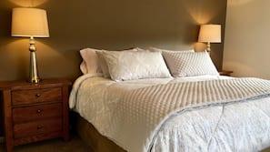 4 bedrooms, premium bedding, iron/ironing board, free WiFi