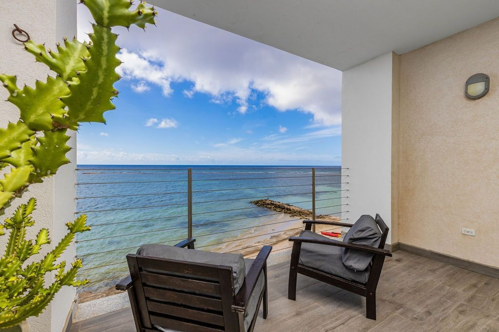 Balcony, 7 Bed/6 Bath Beachfront Villa With Infinity Pool Overlooking The Caribbean