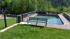 Seasonal outdoor pool, pool loungers