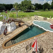 5 Acre Estate With 10 Bedrooms & Giant Pool w/ Slide, Splash Park, & Crazy Golf!