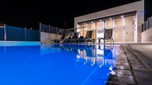 Indoor pool, 2 outdoor pools, open 10:00 AM to 10:00 PM, pool umbrellas