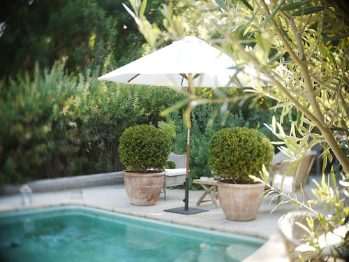 Great Place to stay Brentwood Artist Farmhouse w/ Pool , Private, Surrounded by Century old Trees near Los Angeles