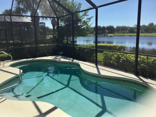 Great Place to stay Three Bedroom 3 Bath Home With Sunset View of Lake and Golf Course near Fort Myers