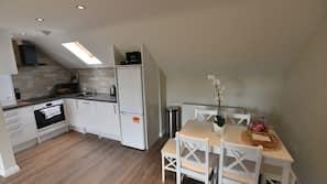 Full-sized fridge, oven, hob, dishwasher