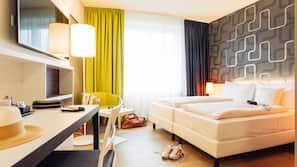 Caja fuerte, escritorio, sistema de insonorización y camas supletorias