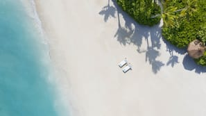 Private beach, white sand, beach cabanas, sun loungers