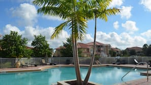 Outdoor pool, open 8:00 AM to 6:00 PM, pool umbrellas, sun loungers
