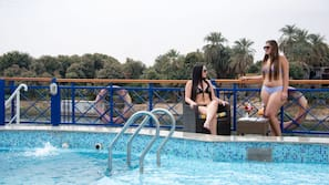 Outdoor pool, open 9:00 AM to 6:00 PM, pool umbrellas, sun loungers