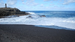 On the beach, black sand