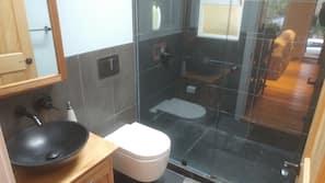 Shower, hair dryer, towels, toilet paper