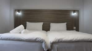 Premium bedding, blackout curtains, free WiFi, bed sheets