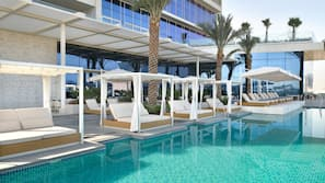 Outdoor pool, open 6:00 AM to 6:30 PM, free cabanas, pool umbrellas