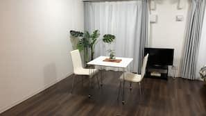 Desk, laptop workspace, blackout curtains, soundproofing