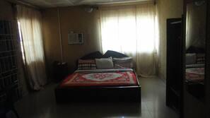 Minibar, desk, blackout drapes, bed sheets