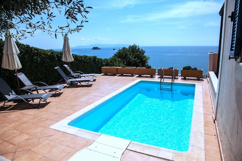 Beach Front Villa in Svoronata with private path of 50 m to a secluded beach!