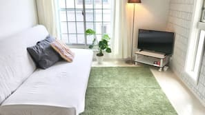 32-inch flat-screen TV with digital channels, TV