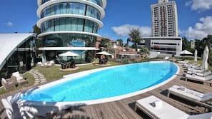 Outdoor pool, open 9:00 AM to 10:30 PM, pool umbrellas