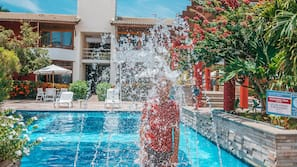 2 outdoor pools, open 10:00 AM to 9:30 PM, pool loungers