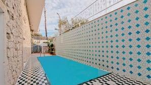 Seasonal outdoor pool, open 8:00 AM to 7:00 PM, free pool cabanas