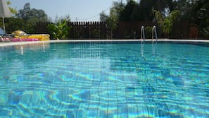 Outdoor pool, open 9:30 AM to 8:30 PM, pool umbrellas, pool loungers
