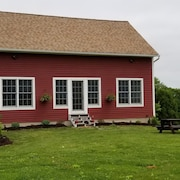 Beautiful Farm House Located On 12 Acres Of Farm Property.
