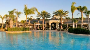 Outdoor pool, open 9:00 AM to 10:00 PM, pool loungers