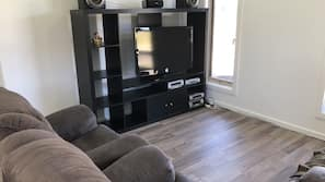 TV, DVD player, ping pong table, books
