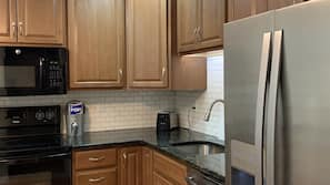 Electric kettle, spices, ice maker, dining tables
