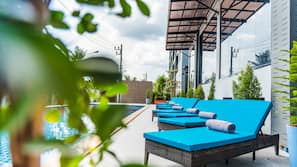 Outdoor pool, open 10:00 AM to 8:00 PM, pool umbrellas