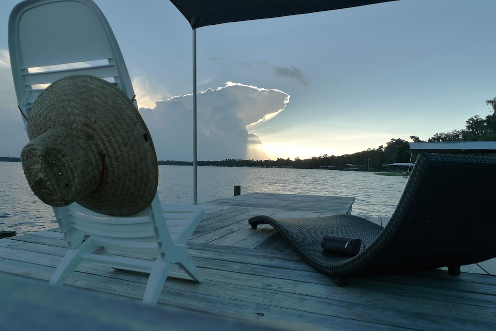 Balcony, Old Florida Sunsets Delights at Lake House Retreat With Spectacular Beach & Dock