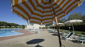 2 outdoor pools, open 9:30 AM to 7:30 PM, pool umbrellas, pool loungers