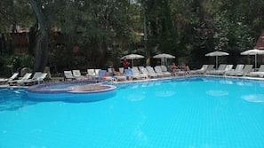 Seasonal outdoor pool, open 7:30 AM to 7:00 PM, pool umbrellas