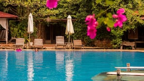 2 outdoor pools, open 7:30 AM to 10:00 PM, pool umbrellas, sun loungers
