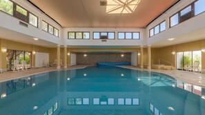 Indoor pool, 2 outdoor pools, open 9:00 AM to 7:00 PM, pool umbrellas