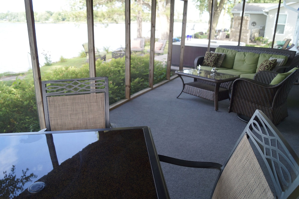 , Relax in the hot tub While Watching the Lake From our Deck!
