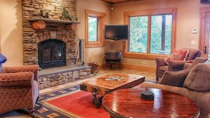 Flat-screen TV, fireplace, DVD player, foosball