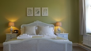 Premium bedding, blackout curtains, free cots/infant beds, rollaway beds