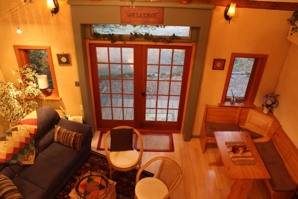 Living Room, Charming Cozy Cottage Secluded in Private Woods in Great Close in Location