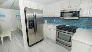 Oven, coffee/tea maker, toaster, cookware/dishes/utensils