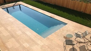 Seasonal outdoor pool, open 9:00 AM to 8:00 PM, sun loungers