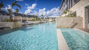 12 outdoor pools, open 8:00 AM to 6:00 PM, pool umbrellas, pool loungers