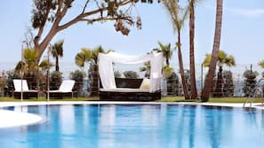 Indoor pool, 2 outdoor pools, open 10:00 AM to 9:00 PM, pool loungers